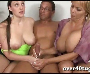 Milf strokes cock with her step daughter