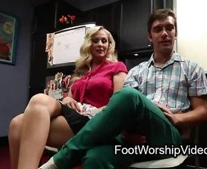 Busty MILF gets her feet sucked